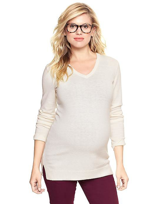 A soft long-sleeved ivory v-neck sweater ($40) from Gap is the perfect answer to crisp Fall days.
