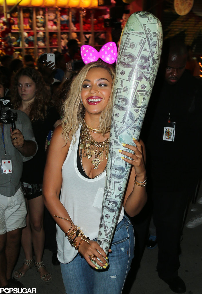 Beyonce wore a bow and carried a big inflatable bat on Coney Island.