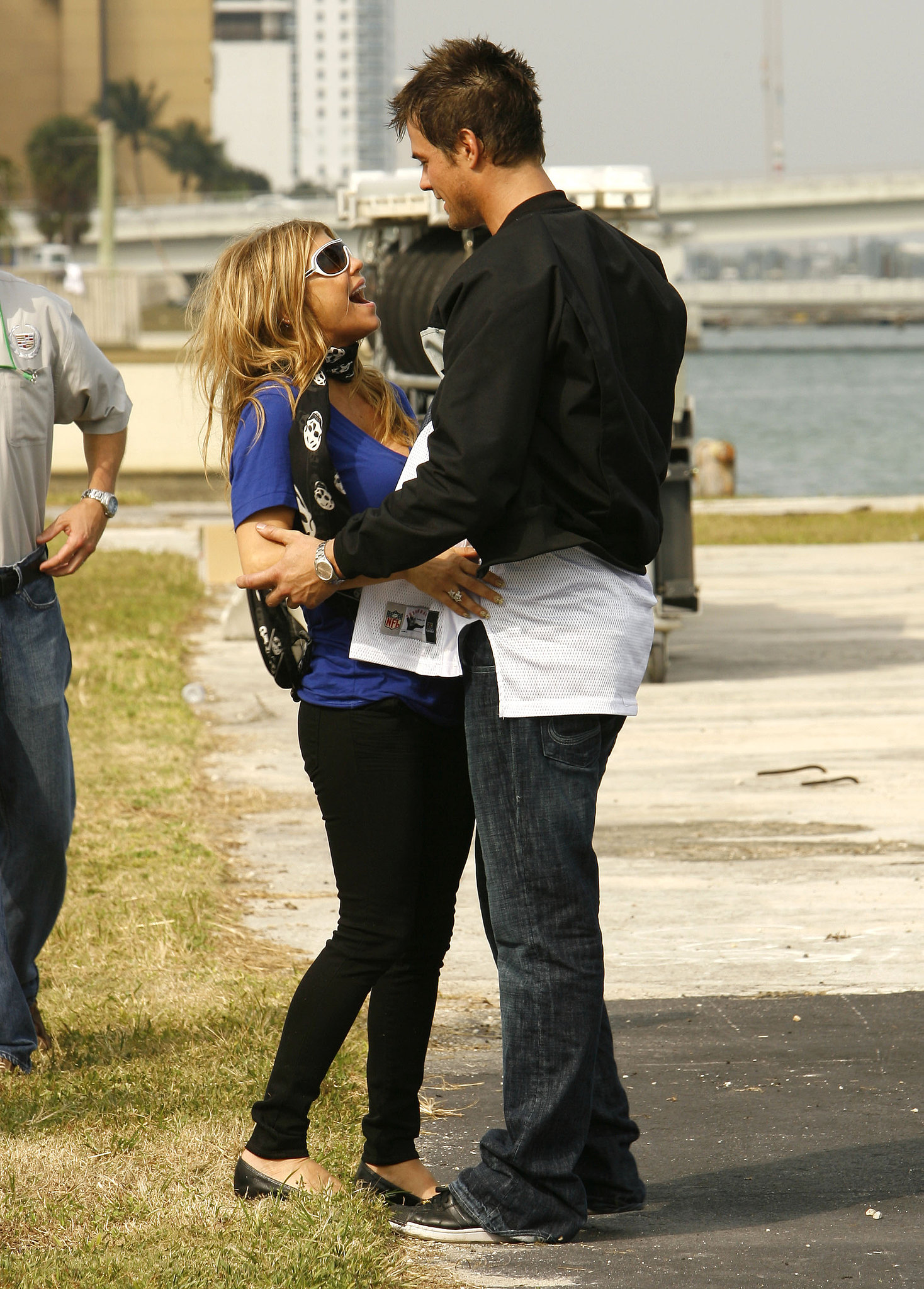 Fergie and Josh Duhamel shared a laugh at the fifth annual Cadillac Super Bowl Grand Prix in Miami in February 2007.