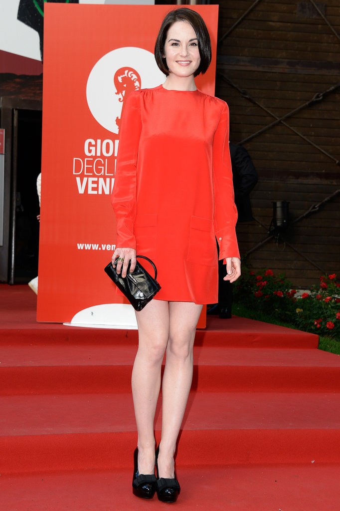 Michelle Dockery matched the red carpet perfectly in her silky red long-sleeved dress at the Miu Miu Women's Tales premiere. A black mini bag and platform pumps added dimension to her Venice style.