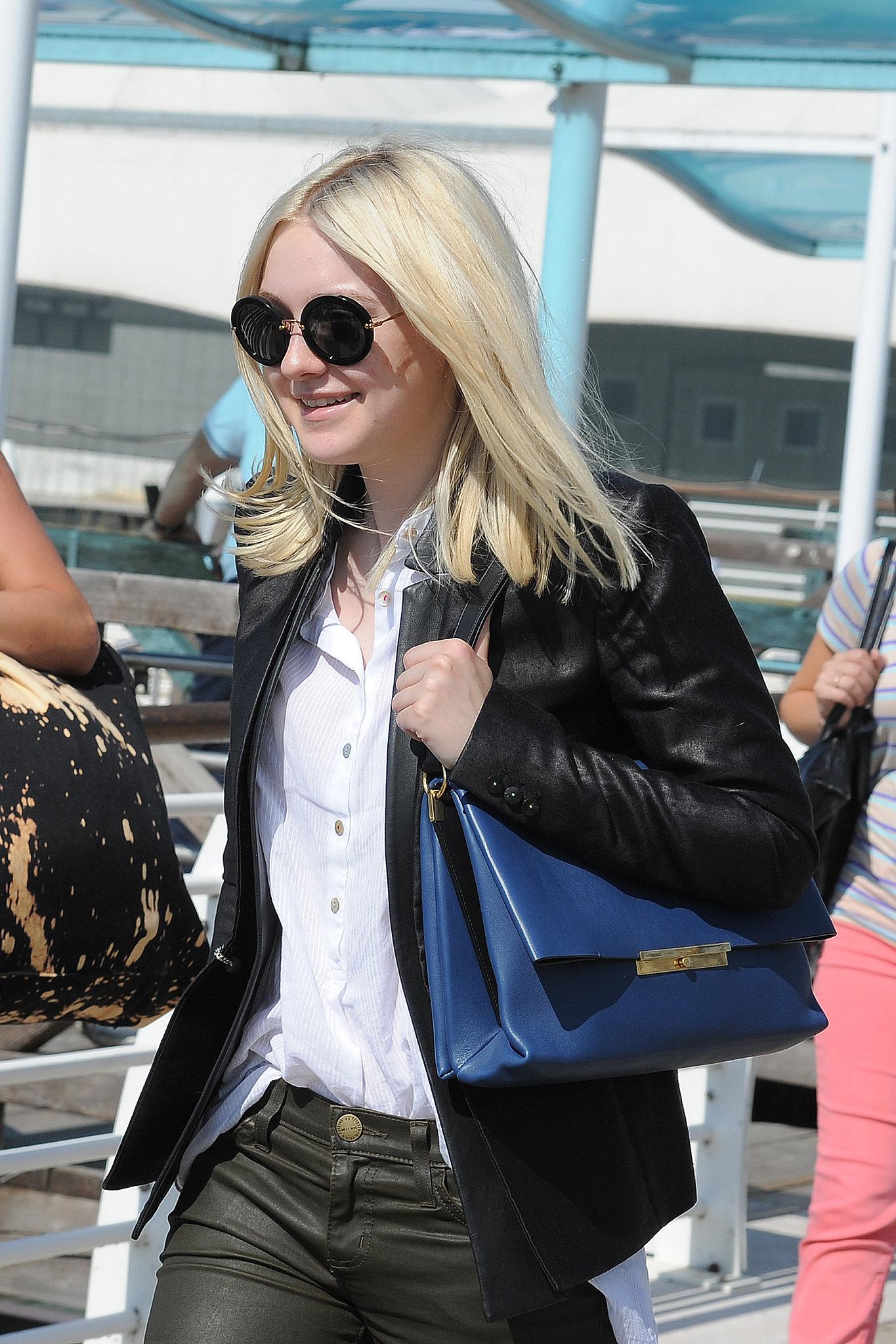 Dakota Fanning arrived at the Venice airport.