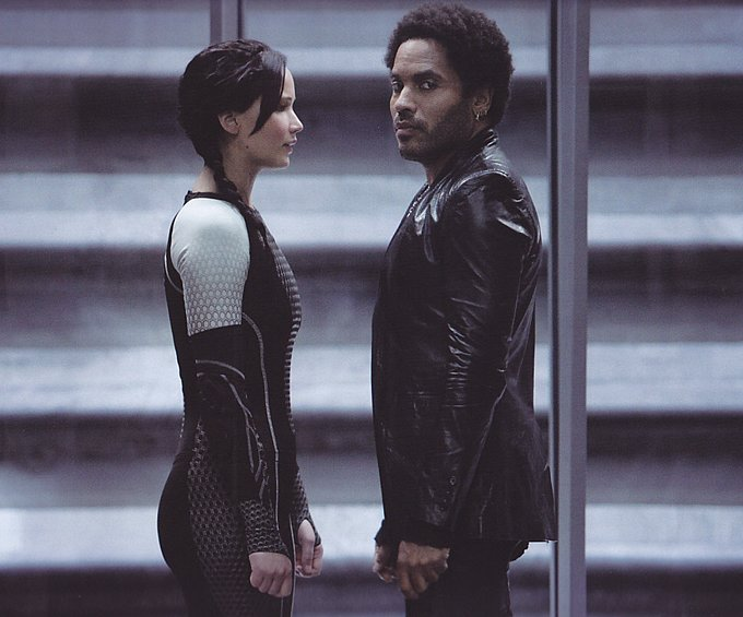 Jennifer Lawrence as Katniss and Lenny Kravitz as Cinna in Catching Fire.