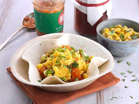 australian eggs scrambled egg spicy stewed tomatoes sweet corn and