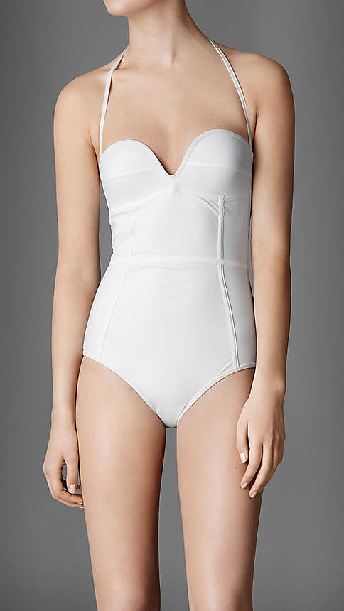 I was saw a well-known magazine fashion editor wearing this in Bondi with a floppy white hat and red lipstick. That image has never left my mind. White one-piece, I'm game if you are? —Alison, POPSUGAR Australia health and beauty editor. One-piece, approx $405, Burberry.