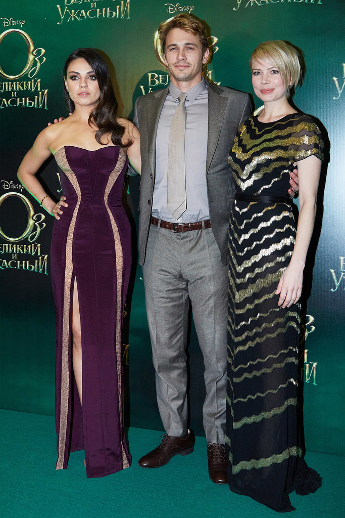 Michelle Williams posed with costars James Franco and Mila Kunis at the Moscow premiere of Oz the Great and Powerful in February 2013.