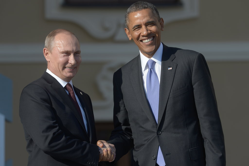 President Obama put on a smile during his official greeting with President Putin.