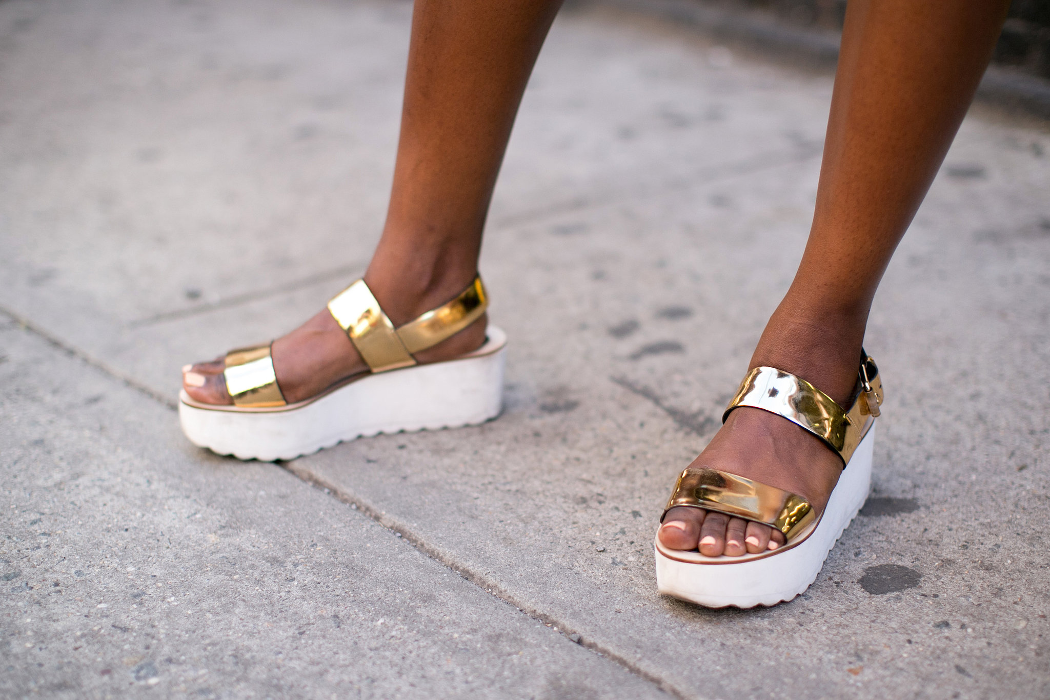 Flatforms in this metallic gold finish were made for turning heads.
