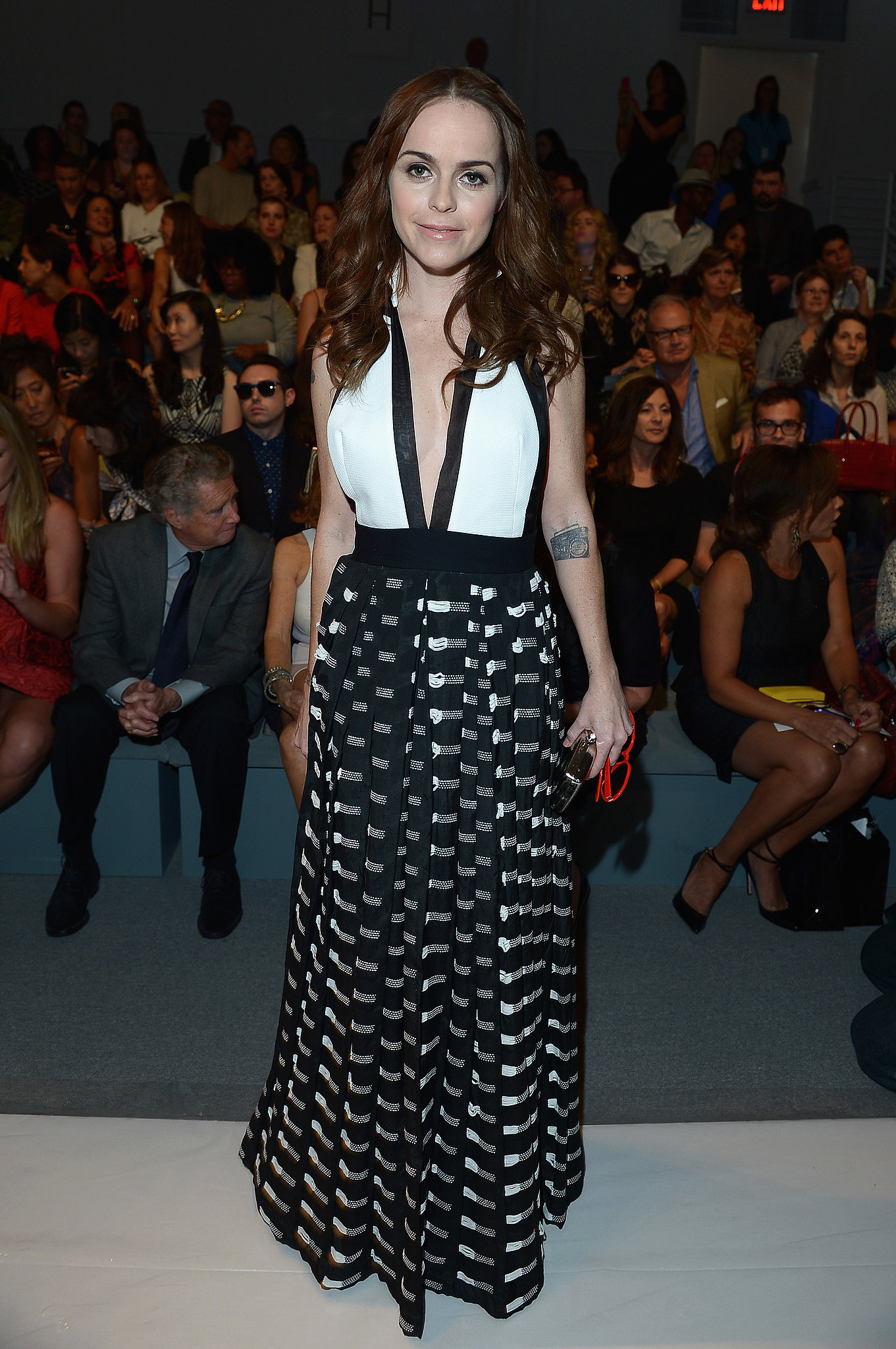 Taryn Manning's black-and-white maxi dress stood out front row at Carmen Marc Valvo.