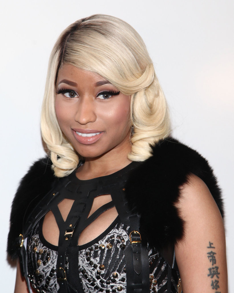 Nicki Minaj at Herve Leger by Max Azria Spring 2014.