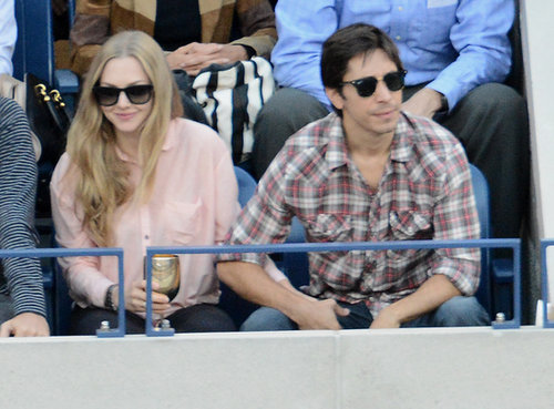 Justin Long and Amanda Seyfried coupled up in the stands.