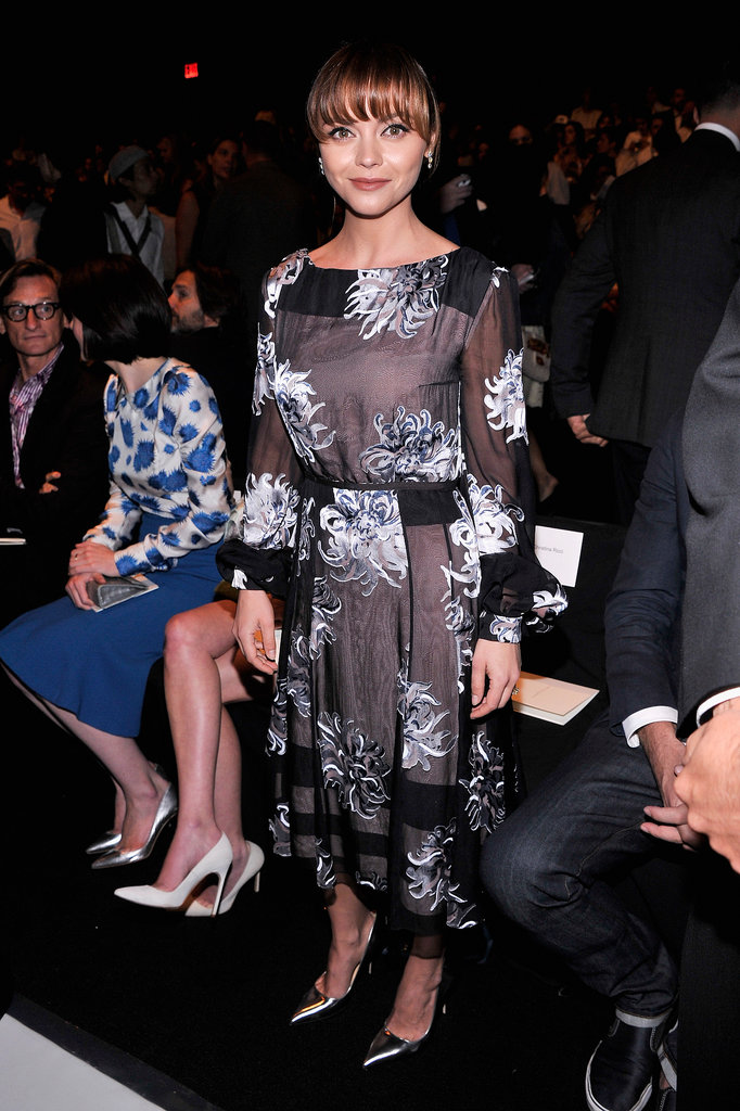 Christina Ricci dressed herself in a sheer floral dress and silver metallic pumps at Carolina Herrera.