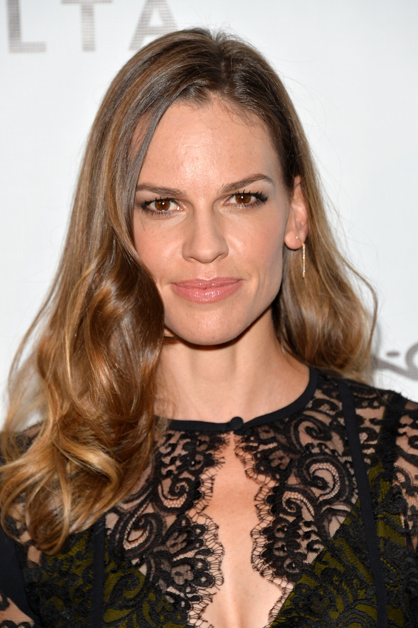 We love Hilary Swank's full-on glam style at the amfAR Inspiration Gala