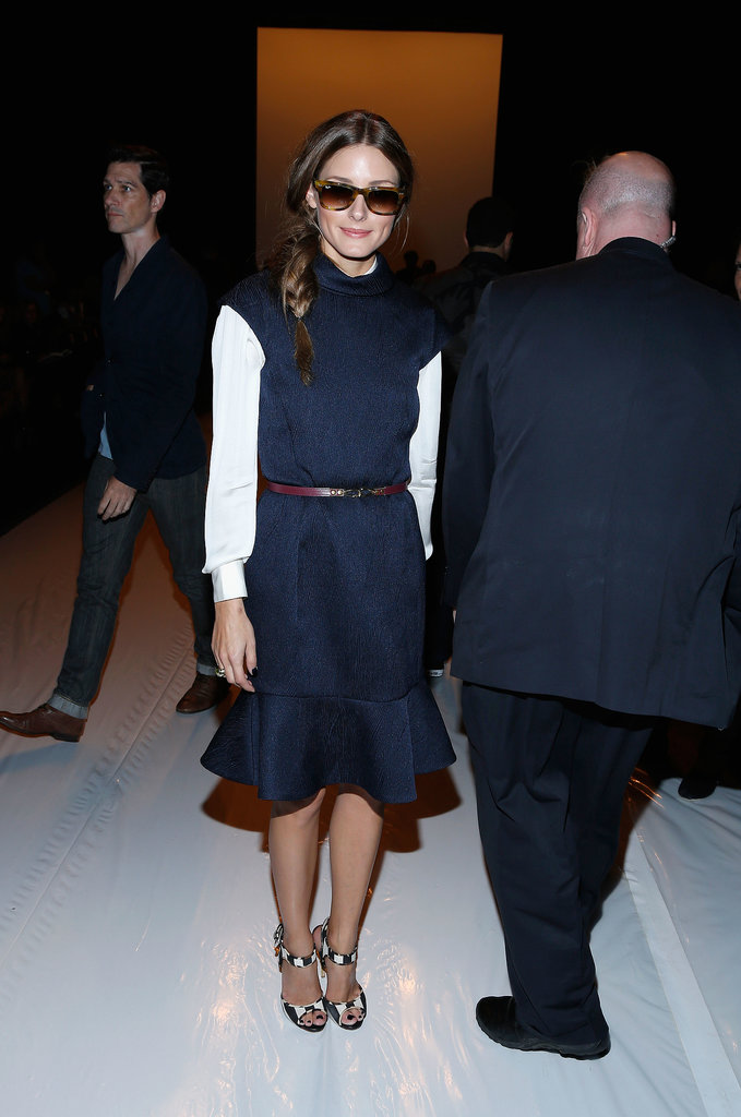 Olivia Palermo was feminine in a navy dress with a dramatic ruffle hemline at the Kaufmanfranco show.