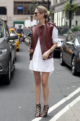 She toughened up a white shirt dress with burgundy leather and hot heels.