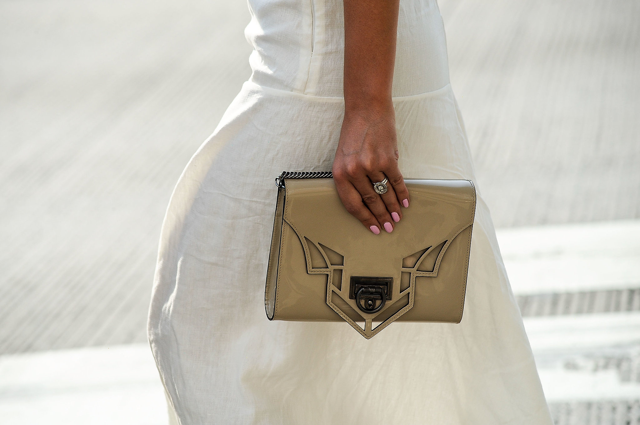 An understated clutch paired perfectly with a simple white dress.
