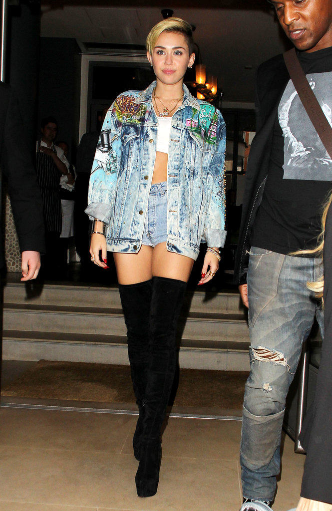 Miley Cyrus left her London hotel on Sept. 11 in an embellished denim jacket, tiny shorts and thigh-high boots.
