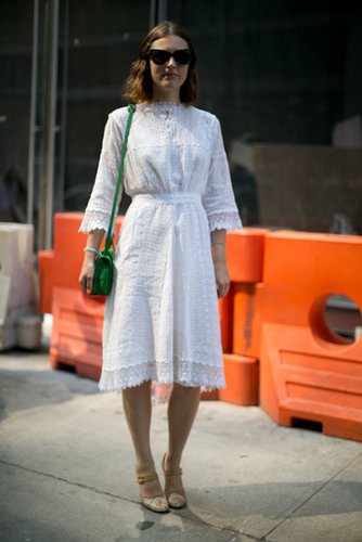 A bright green bag was a welcome pop of color against a pretty white dress.