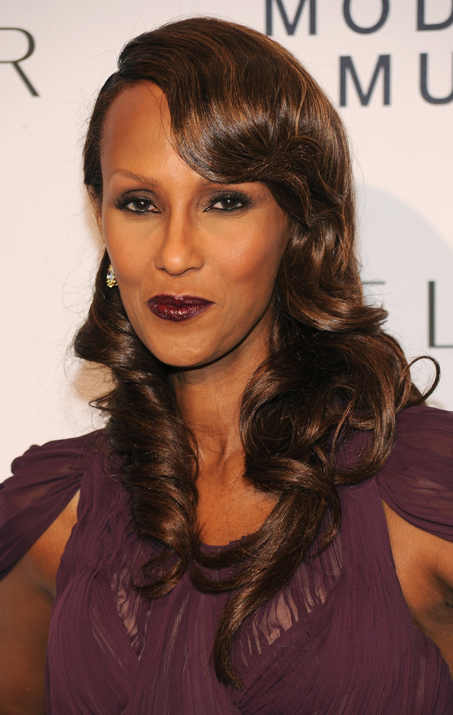 With purple lips to match her dress and a vintage hairstyle, Iman looked downright glamorous.