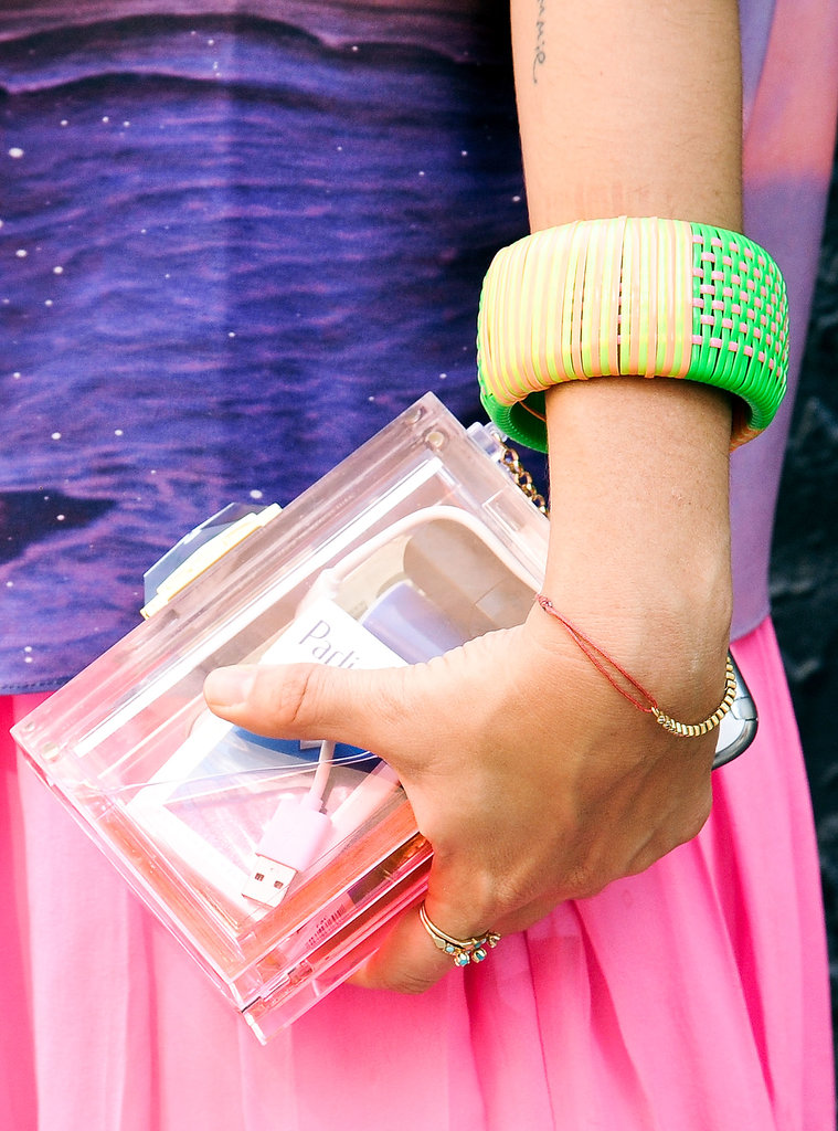 A lucite clutch looked lovely against a splash of color.