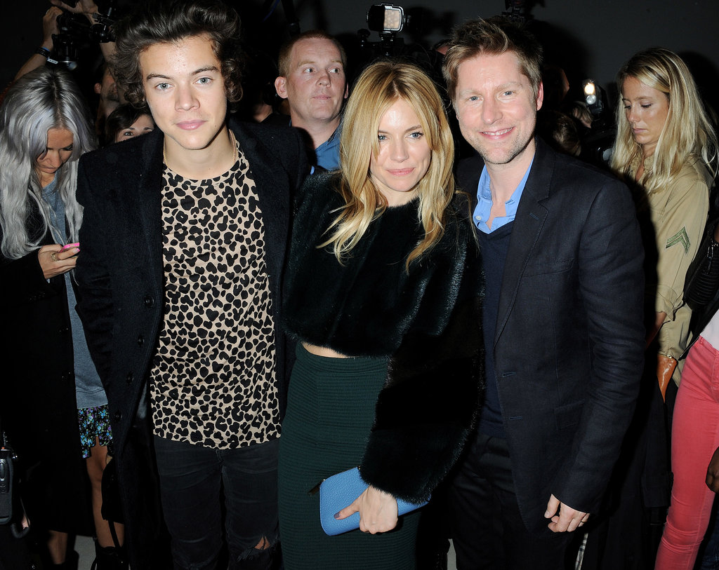Harry Styles snapped a picture with Sienna Miller and Christopher Bailey backstage at Burberry Prorsum during London Fashion Week.