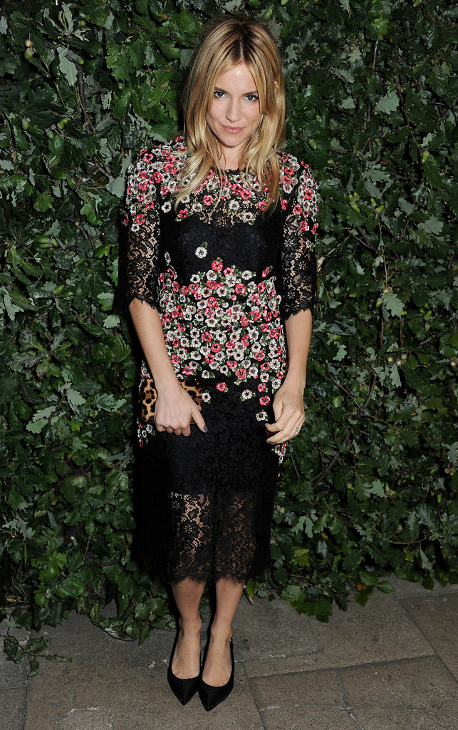 Sienna Miller sported a floral frock for the Global Fund party during London Fashion Week.