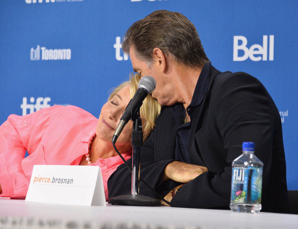 Emma Thompson and Pierce Brosnan got affectionate at the press conference for The Love Punch.