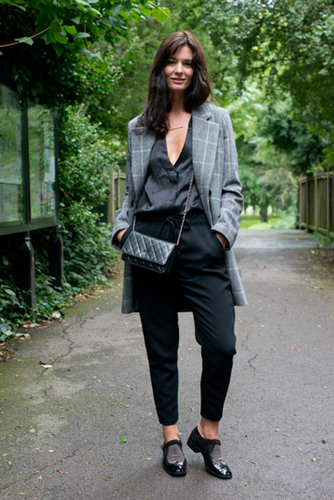Her play on the classics was spot on with a checked coat, studded brogues, and a little Chanel bag.