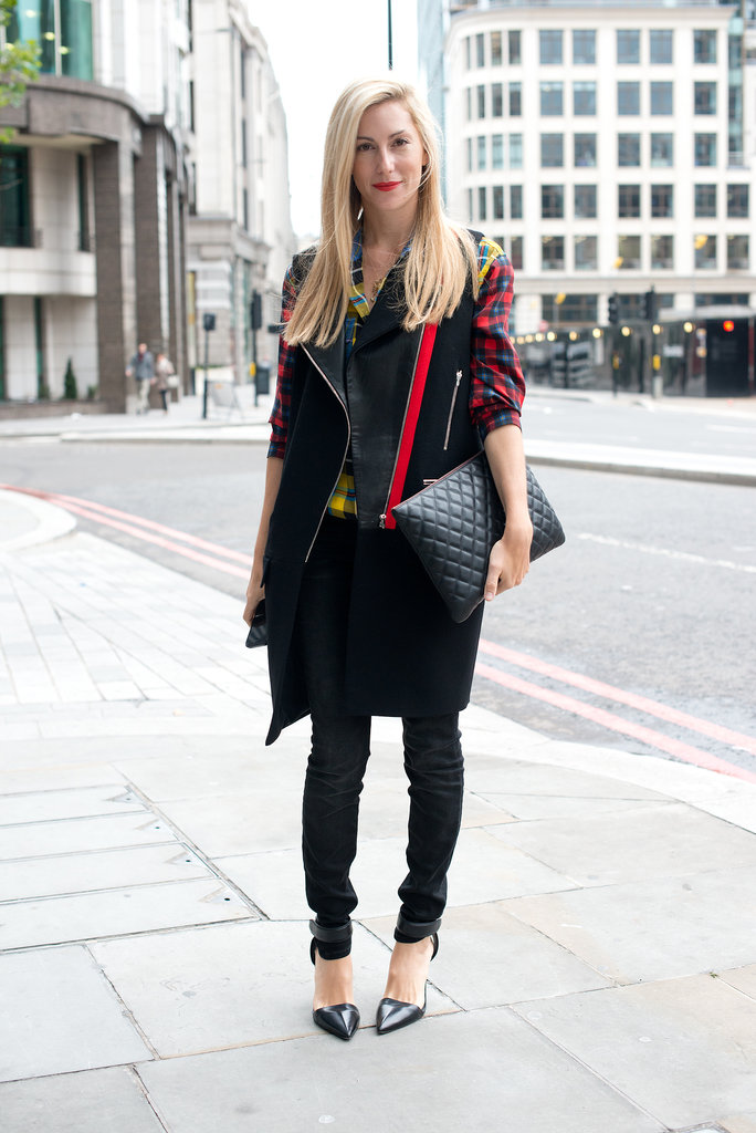 Joanna Hillman adopted the London dress code with a biker vest and a plaid button-down.