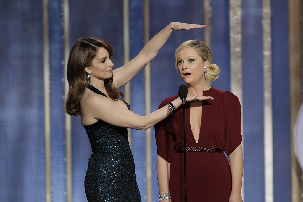 "Tina and Amy killed it as Golden Globes hosts in 2013. Their opening monologue included jokes like Amy's quip: ""It was a great year for women in film — Kathryn Bigelow, nominated tonight. I haven't really been following the controversy over Zero Dark Thirty, but when it comes to torture, I trust the lady who spent three years married to James Cameron."" And Tina tickled our funny bone with this line: ""This next presenter is so good-looking, he makes young George Clooney look like garbage. Please welcome, middle-aged George Clooney."""