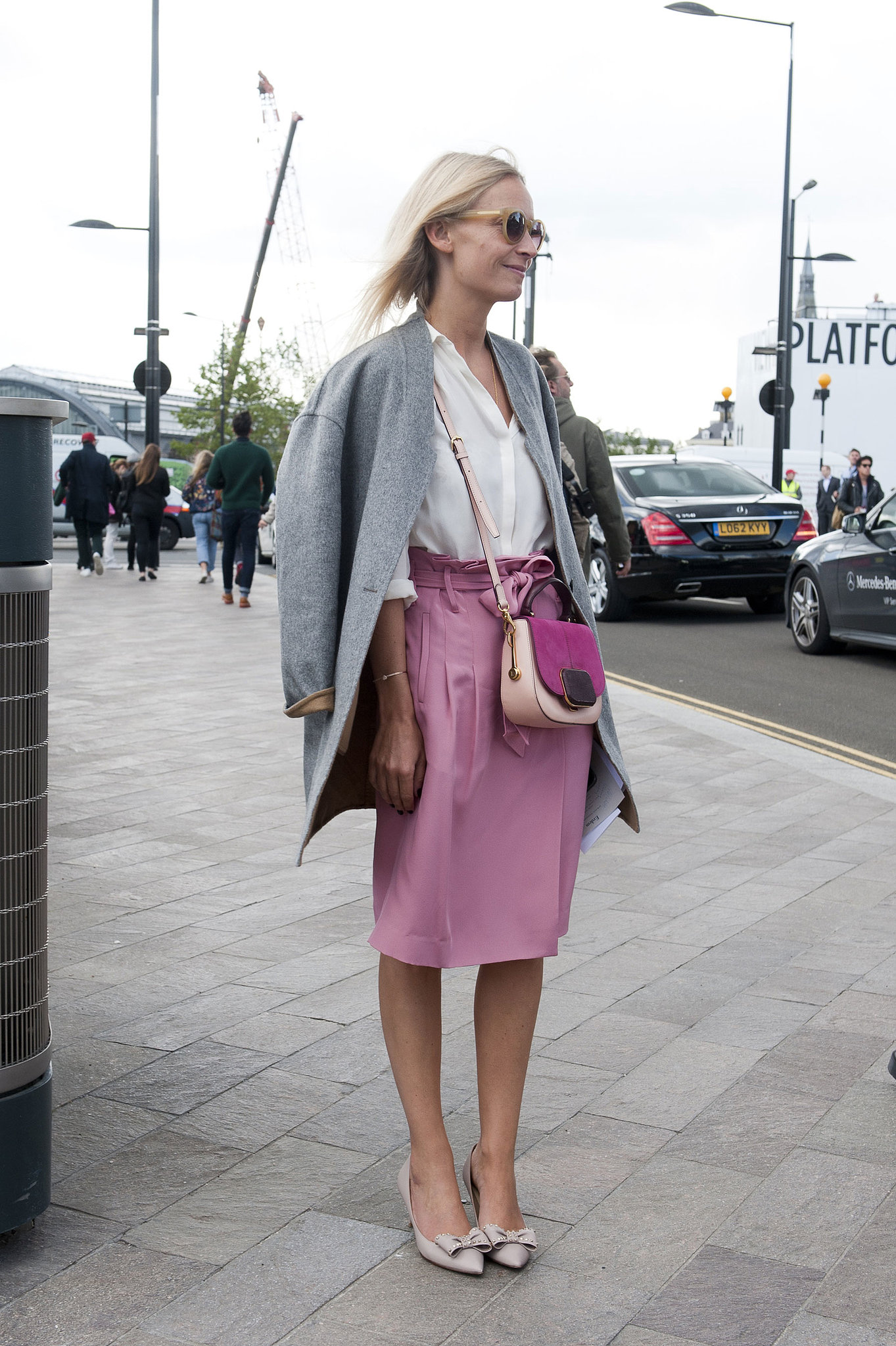Not too girlie, but with bows on her heels and pink on her skirt, this look is completely lovely.