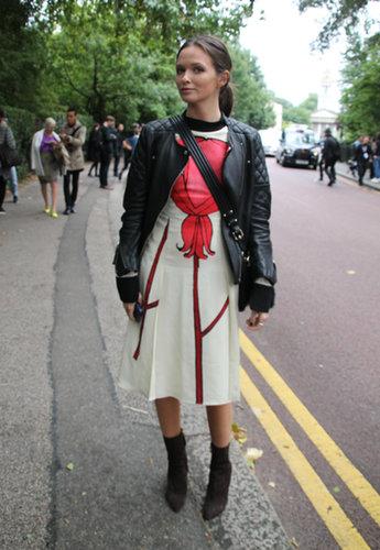 A ladylike dress with a tough-girl layering job. Source: Hannah Freeman