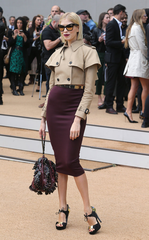 Elena Perminova readied for the front row of Burberry Prorsum in the label's sculpted ensemble.