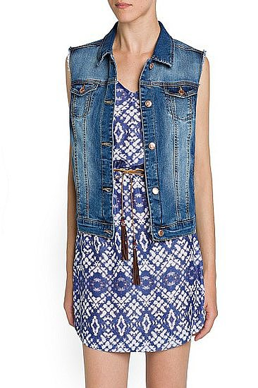 This roomier fit Mango medium-wash denim gilet ($40) provides a tomboy counter to your dresses.