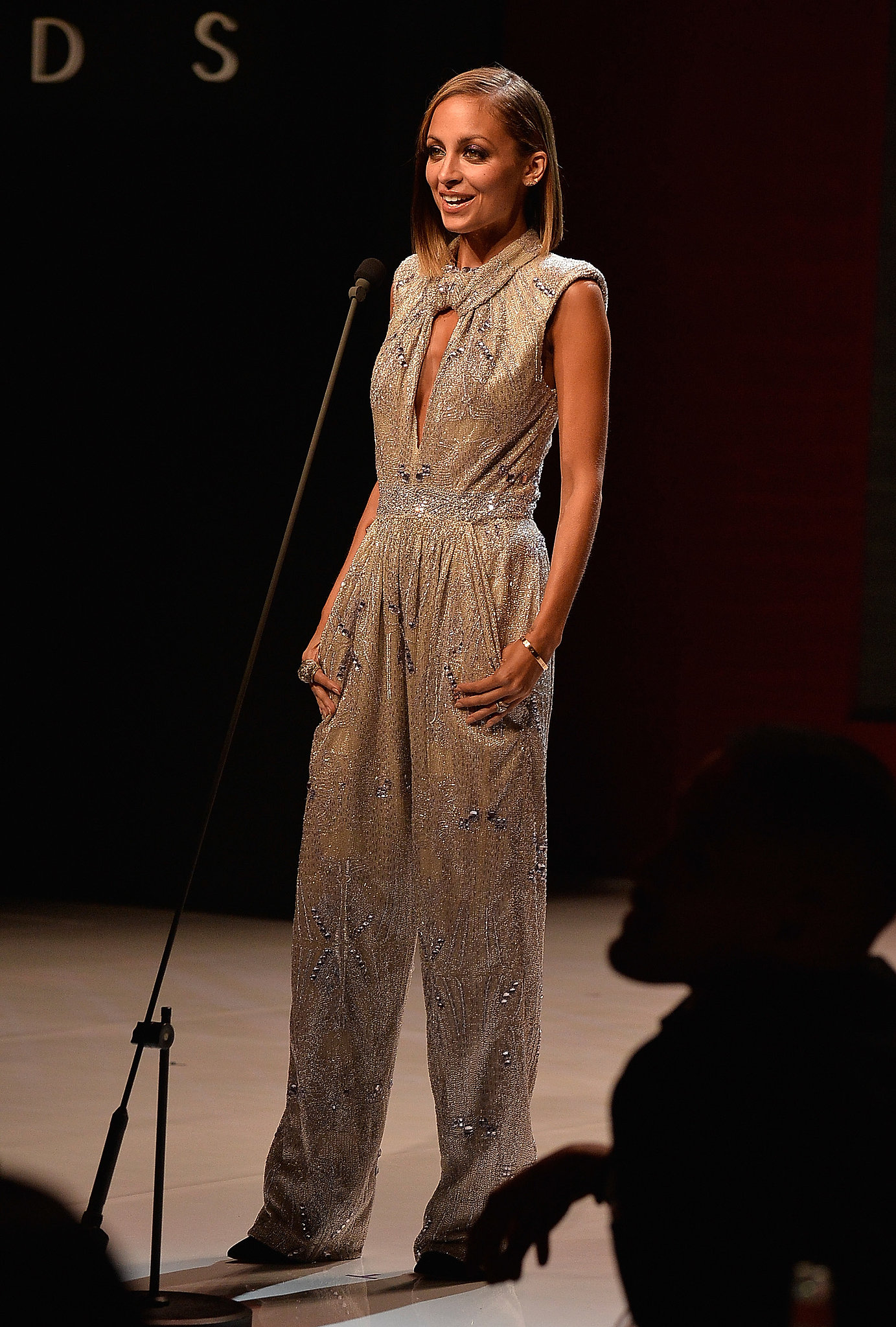 Nicole sported a sequin Giorgio Armani jumpsuit while hosting the Style Awards in NYC in September 2013.