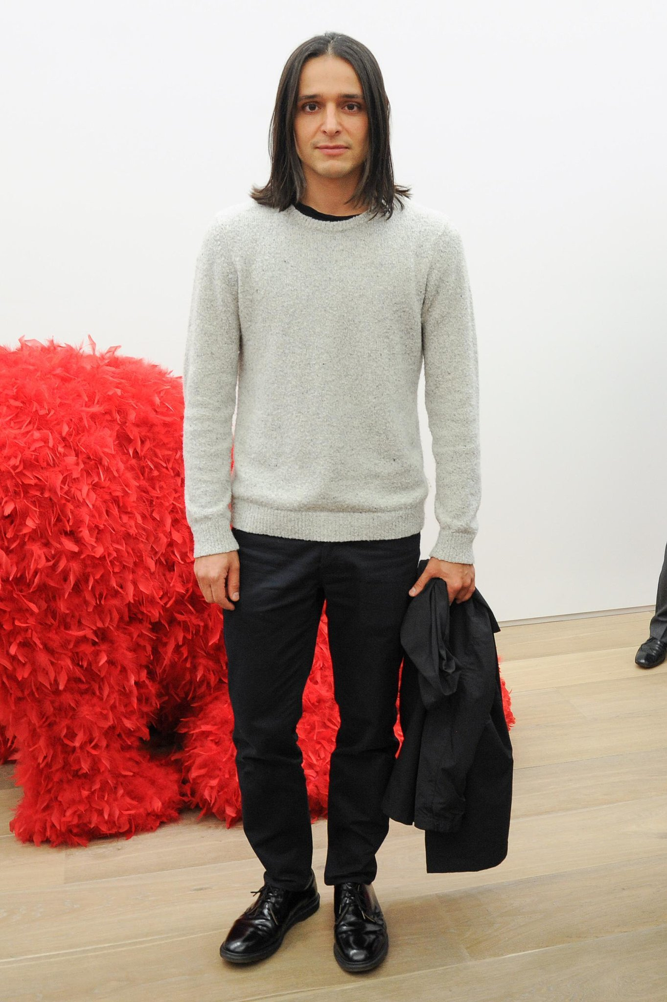Olivier Theyskens was casual and cool in a dressed-down sweater at the Preview of Paola Pivi's Inaugural Exhibition.