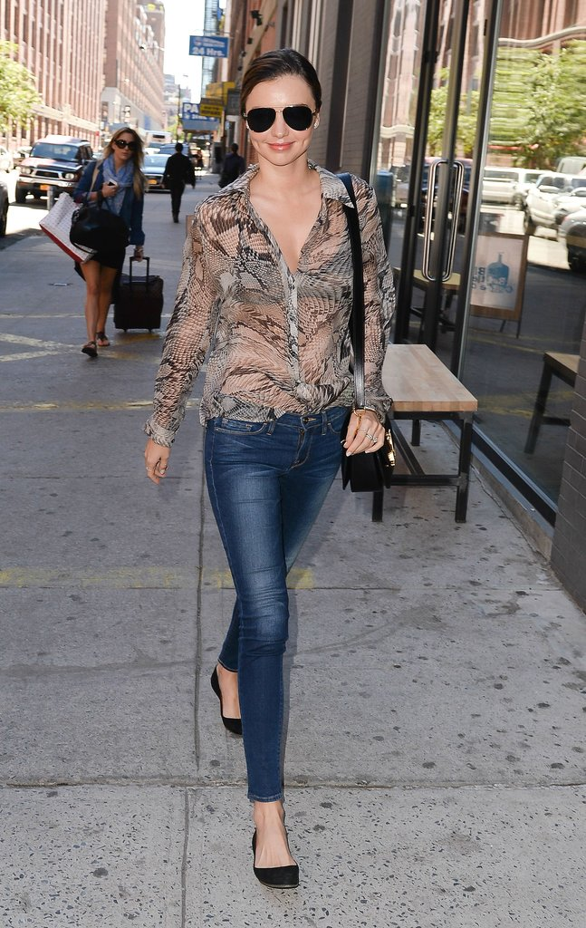 Miranda Kerr does dressed-down denim like no other, teaming dark aviators with skinny denim and a sheer printed shirt while in New York.