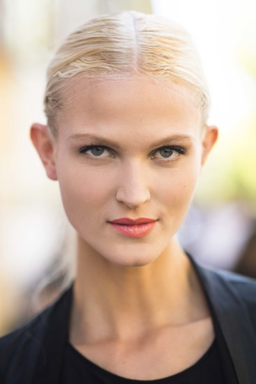 The combination of a low ponytail and bright lipstick is fun and flirty.  Source: Le 21ème | Adam Katz Sinding