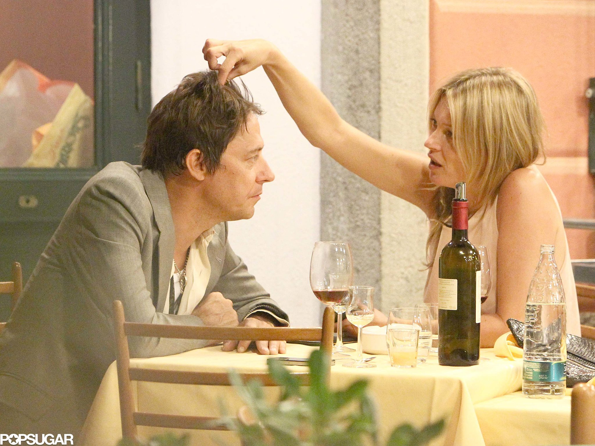 Kate Moss tousled Jamie Hince's hair.