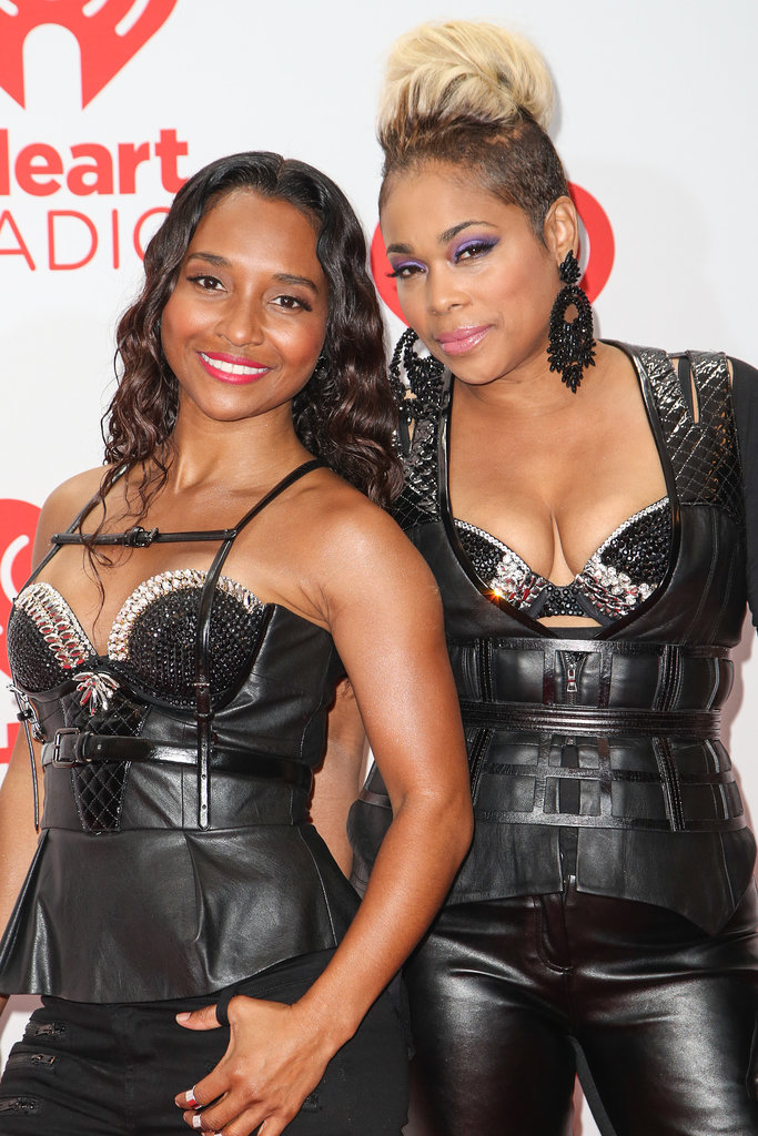 Chilli and T-Boz of TLC fame each chose a feature to accent: Chilli played up her smile with a bright reddish-pink lip hue, while T-Boz accented her eyes with a rich purple shadow.