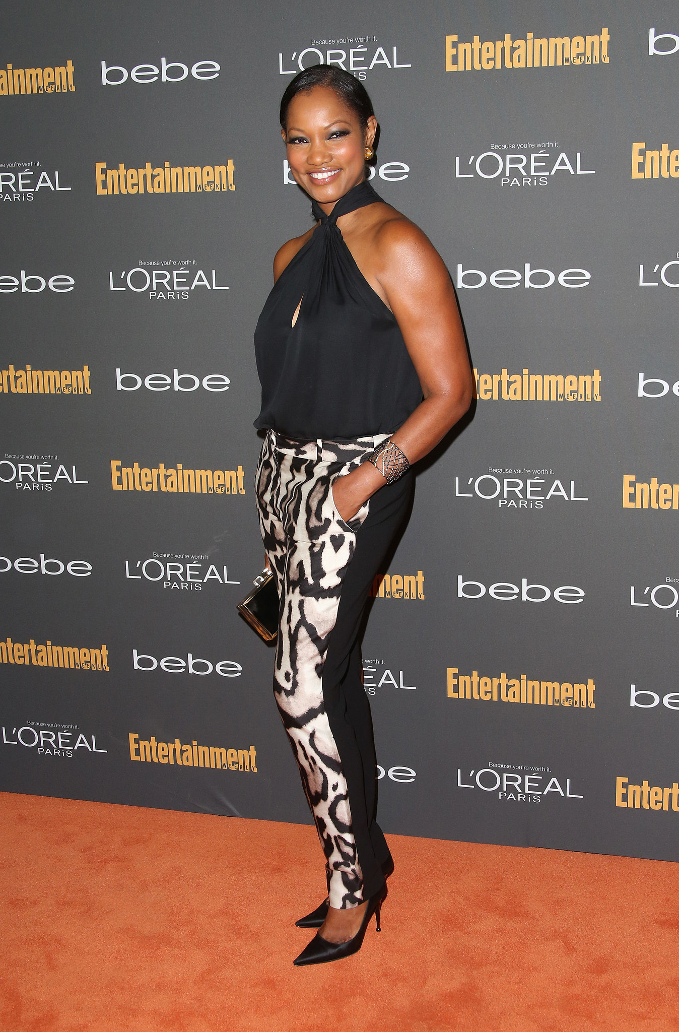 Garcelle Beauvais was one of the only pre-Emmys party attendees that kept it casual chic in a pair of animal-print trousers and a black halter top.