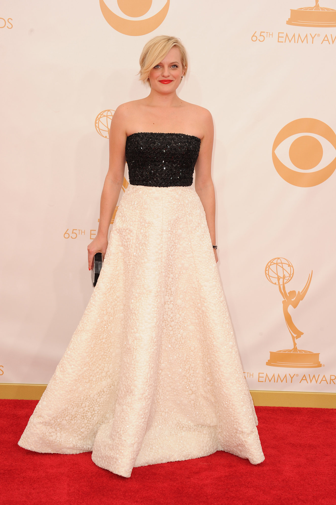 Elisabeth Moss, in a two-tone Andrew Gn dress, clearly couldn't settle for a single shade! She finished it off with vintage Neil Lane jewelry and a Rauwolf bag.