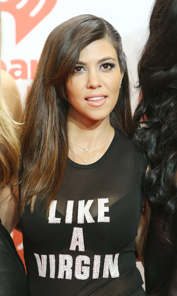 Kourtney Kardashian paired her peachy cheek and lip hue with an on-trend, deep side sweep.