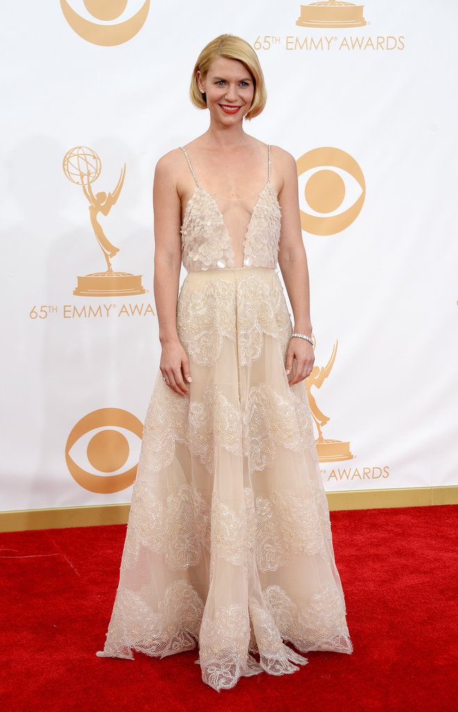 Homelandactress and now triple Emmy Award Winner Claire Danes didn't disappoint on the red carpet, looking every bit the leading lady in a plungingArmani Privedress,Neil Lanejeweller,customChristian Louboutinshoesand a Todsclutch.
