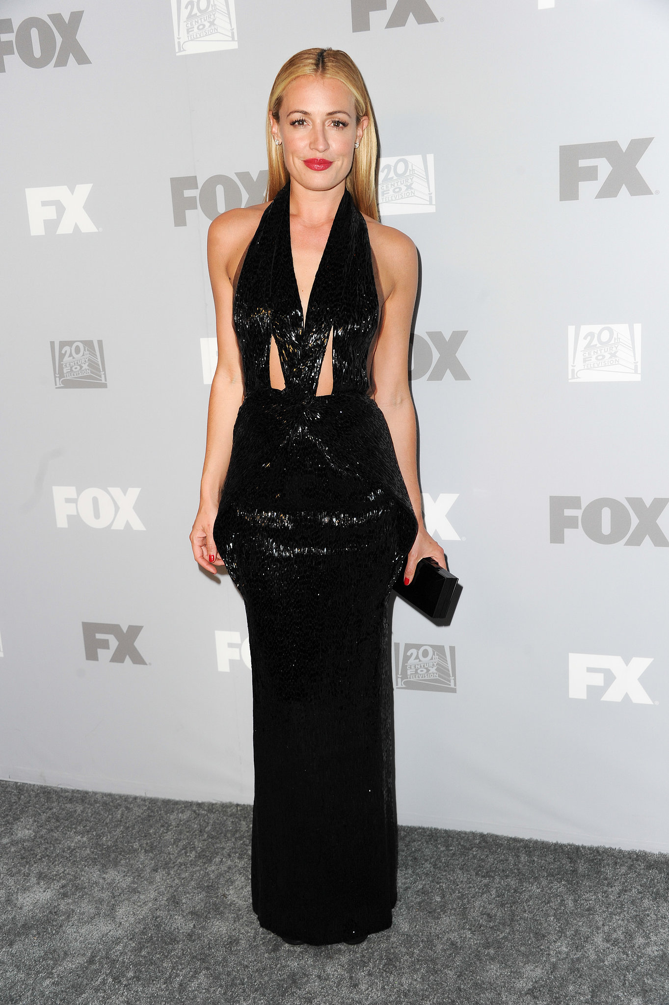 Between the sequins and the cutouts, Cat Deeley's black halter gown at the Fox afterparty was simply dazzling. She finished with Jimmy Choo sandals.