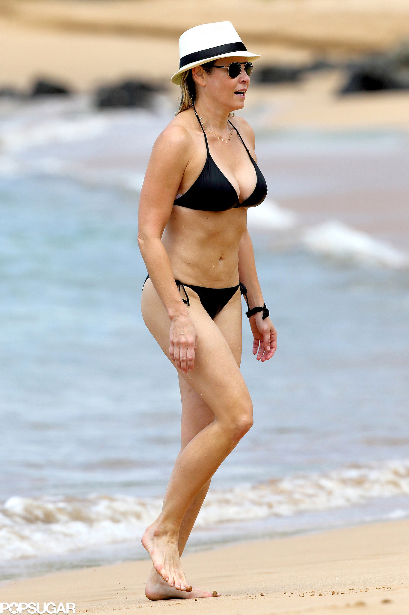 With her slim body and Regular blond hairtype without bra (cup size 34C) on the beach in bikini