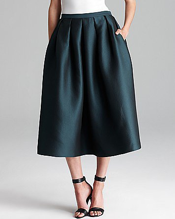 How gorgeous is this decadent Tibi midi skirt ($395)? Dress it down with a leather jacket and ankle boots for the day, then go full glamour girl with a crop top and sexy sandals come nightfall. — Mandi Villa, contributing editor