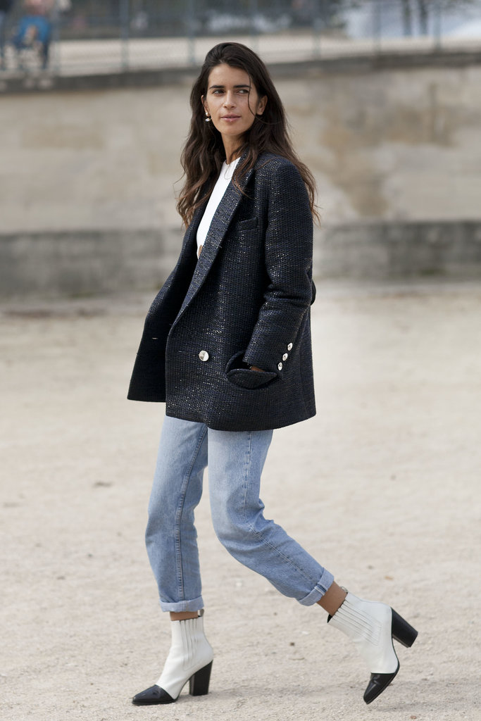 Dressing up denim with a great coat and sleek boots.
