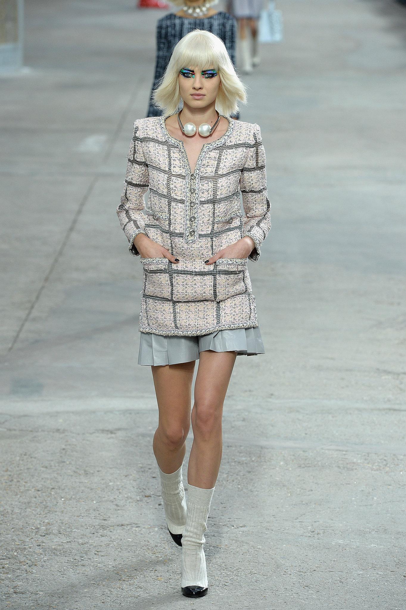 Miranda Kerr walked in the Chanel Spring 2014 fashion show.
