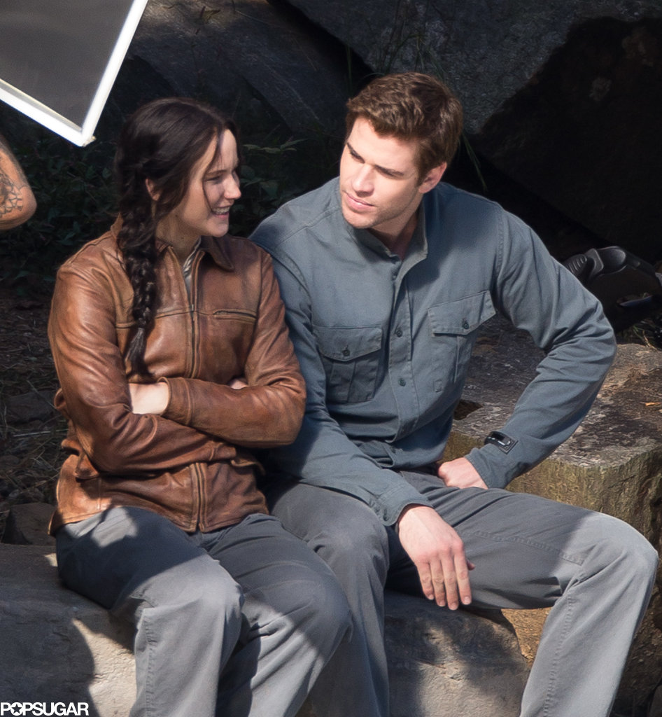Jennifer Lawrence smirked on set with Liam Hemsworth.