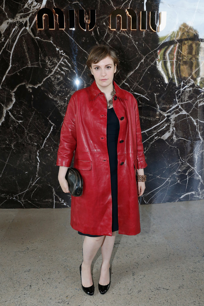 Lena Dunham was dressed up in a red coat for the Miu Miu runway show on Wednesday.